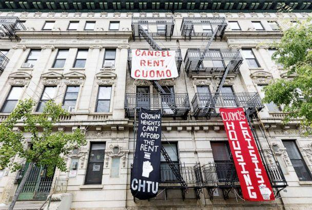 PHOTO: Signs hang on an apartment building calling on New York Governor Andrew Cuomo to cancel the rent as part of an organized rent strike in conjunction with May Day in Brooklyn, New York, May 1, 2020. (Justin Lane/EPA via Shutterstock)