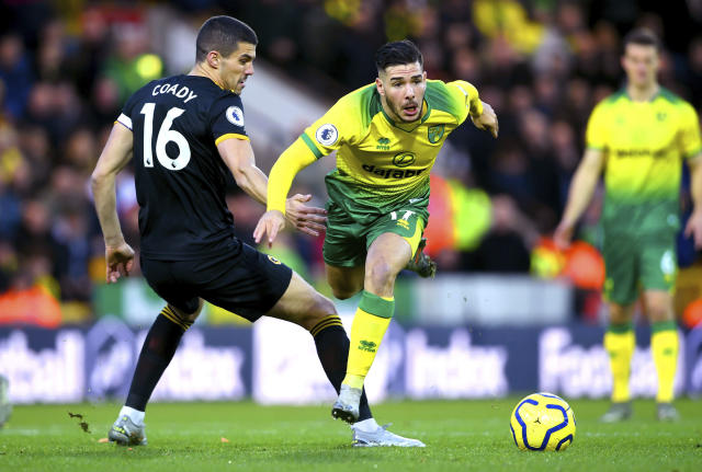 Wolverhampton Wanderers' Conor Coady, left and Norwich City's Emi Buendia battle for the ball during the English Premier League soccer match between Norwich and Wolverhampton Wanderers, at Carrow Road, in Norwich, England, Saturday Dec. 21, 2019. (Joe Giddens/PA via AP)