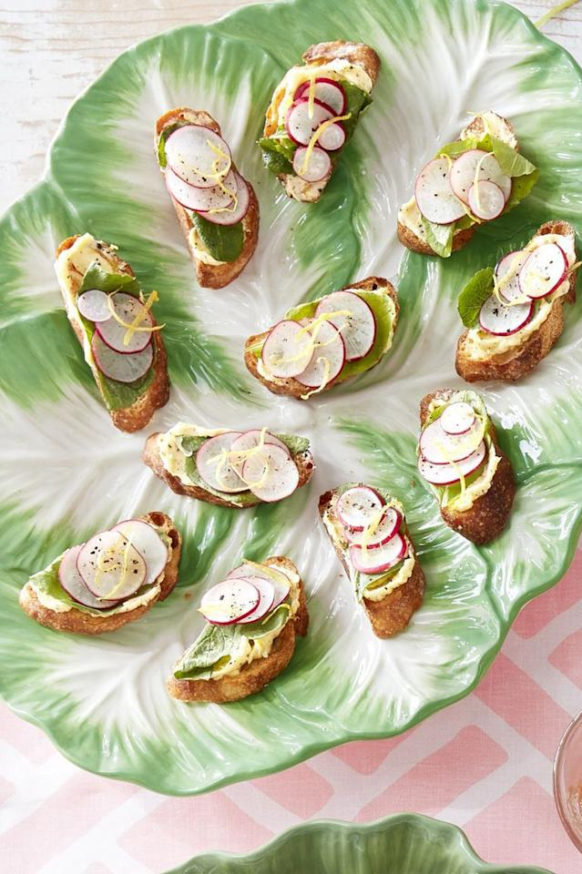 "<p>These radish toasts are the perfect finger food to pass around at your Easter gathering for a crispy, bold bite.</p><p><strong><a href=""https://www.countryliving.com/food-drinks/a30874584/sliced-radish-and-radish-leaf-toasts-with-lemon-butter/"">Get the recipe</a>.</strong></p><p><strong><strong><a class=""body-btn-link"" href=""https://www.amazon.com/Spring-Chef-Premium-Swivel-Vegetable/dp/B00X597ZXS/?tag=syn-yahoo-20&ascsubtag=%5Bartid%7C10050.g.4079%5Bsrc%7Cyahoo-us"" target=""_blank"">SHOP VEGETABLE PEELERS</a></strong><br></strong></p>"