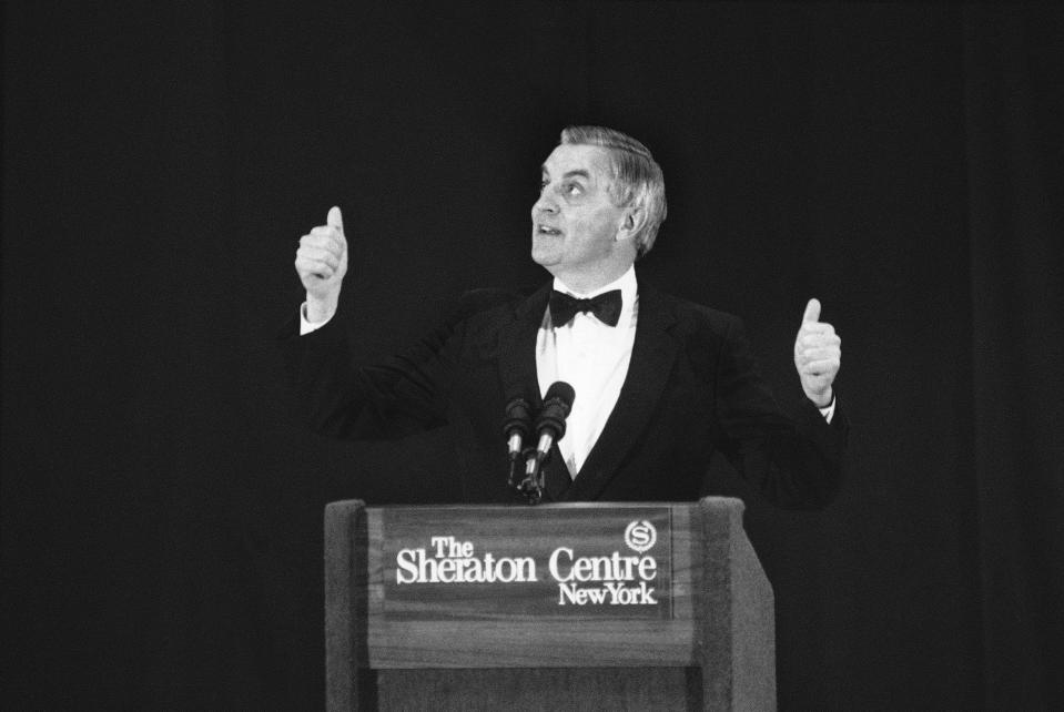 FILE - In this Wednesday, Oct. 11, 1984, file photo, presidential candidate Walter Mondale gestures while speaking at a Democratic fundraising dinner, in New York. Mondale, a liberal icon who lost the most lopsided presidential election after bluntly telling voters to expect a tax increase if he won, died Monday, April 19, 2021. He was 93. (AP Photo/Richard Drew, File)