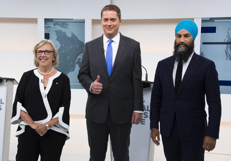 Green Leader Elizabeth May, left, Conservative Leader Andrew Scheer, center, and NDP Leader Jagmeet Singh pose for a photograph before the Maclean's/Citytv National Leaders Debate in Toronto, on Thursday, Sept. 12, 2019. (Frank Gunn/The Canadian Press via AP)