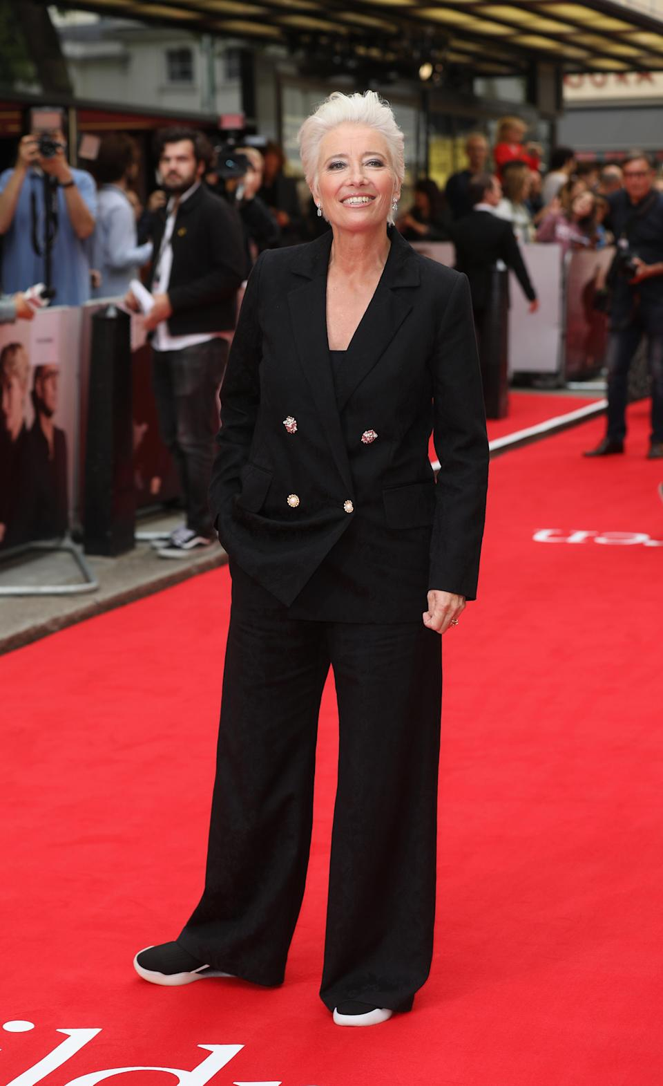 <p>The iconic English actress played it cool in an oversized, trouser suit and trainers.<em> [Photo: Getty]</em> </p>