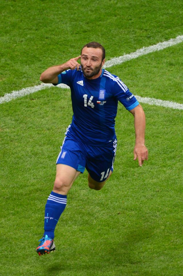 WARSAW, POLAND - JUNE 08: Dimitris Salpigidis of Greece celebrates scoring their first goal during the UEFA EURO 2012 group A match between Poland and Greece at The National Stadium on June 8, 2012 in Warsaw, Poland. (Photo by Shaun Botterill/Getty Images)