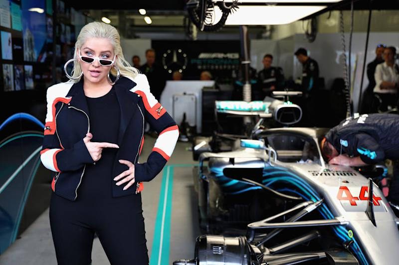 Christina Aguilera poses for a photo in the Mercedes garage before the Azerbaijan Formula One Grand Prix at Baku City Circuit on April 29, 2018 in Baku, Azerbaijan. Photo courtesy of Getty Images.