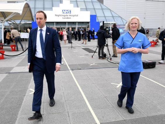 Health secretary Matt Hancock and chief nursing officer for England Ruth May attend the opening of the Nightingale hospital (AFP )