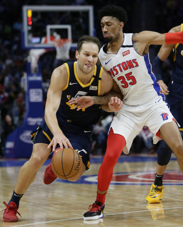 Utah Jazz forward Bojan Bogdanovic (44) drives against Detroit Pistons forward Christian Wood (35) during the second half of an NBA basketball game Saturday, March 7, 2020, in Detroit. (AP Photo/Duane Burleson)