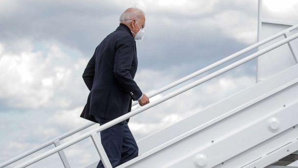 PHOTO: Democratic presidential nominee Joe Biden boards a plane as he departs on campaign travel to Michigan from New Castle Airport in New Castle, Del., Oct. 2, 2020. (Brendan Mcdermid/Reuters)