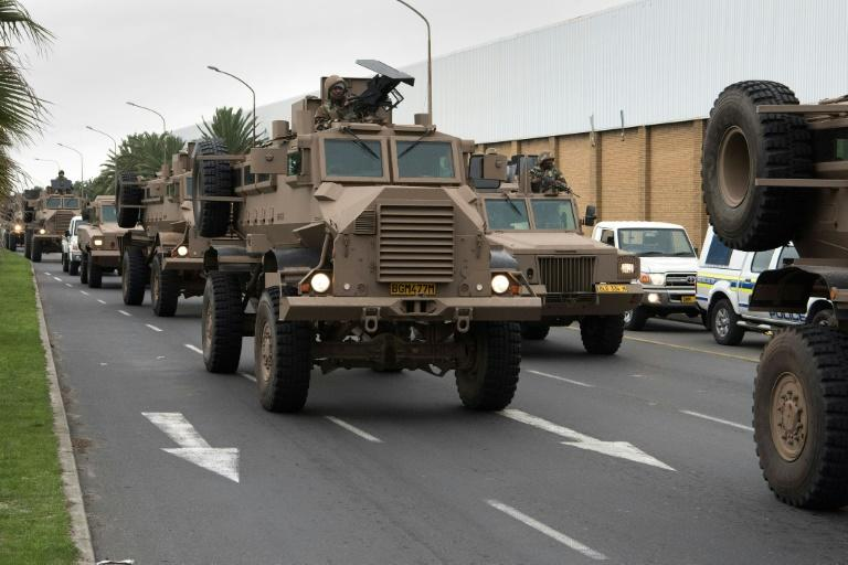 A convoy of South African army vehicles drives through a street in Cape Town as part of the deployment (AFP Photo/RODGER BOSCH)