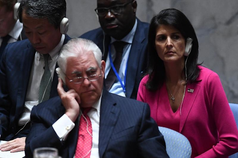 US Secretary of State Rex Tillerson (L) and Ambassador to the UN Nikki Haley (R) listen as China's Foreign Minister Wang Yi (not in picture) speaks during a security council meeting on North Korea at the UN headquarters in New York on April 28, 2017