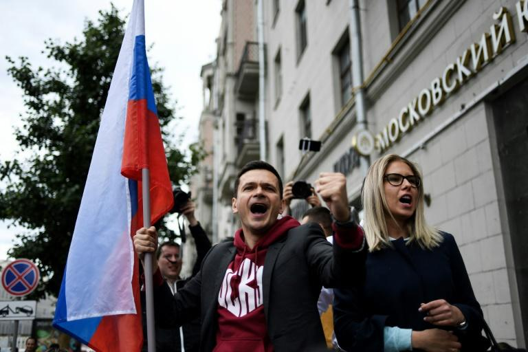 Prominent opposition candidates Ilya Yashin, left, and Lyubov Sobol speak at the Monday rally in Moscow