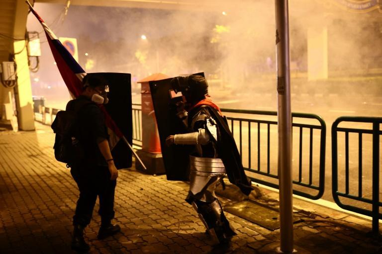 Police fired tear gas as things heated up briefly during the pro-democracy protests (AFP/Jack TAYLOR)