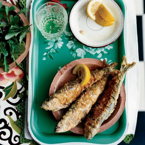 "<p>The traditional Galician preparation is to simply grill the freshly caught sardines over hot coals. Instead, Janet Mendel fills the tender fish with a sweet-salty ham-and-raisin stuffing and fries them to make a crunchy starter that loves a crisp Albariño. For a light meal, serve these sardines with a mesclun salad and fresh lemon juice. </p><p><a href=""https://www.foodandwine.com/recipes/stuffed-fried-sardines"">GO TO RECIPE</a></p>"