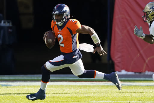Denver Broncos quarterback Kendall Hinton (2) scrambles against the New Orleans Saints during the first half of an NFL football game, Sunday, Nov. 29, 2020, in Denver. (AP Photo/Jack Dempsey)