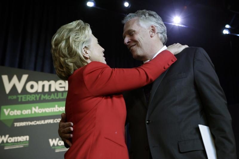 Former U.S. Secretary of State Hillary Clinton greets former DNC chairman Terry McAuliffe at an event to endorse him as Virginia gubernatorial candidate at The State Theatre in Falls Church, Virginia, October 19, 2013. REUTERS/Yuri Gripas (UNITED STATES - Tags: POLITICS ELECTIONS)