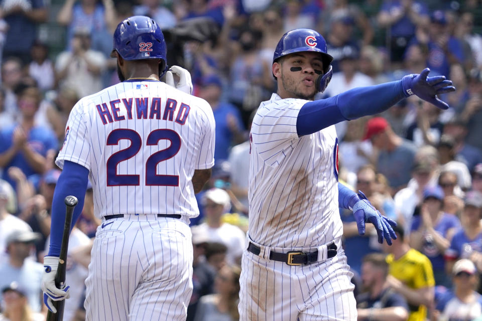 Chicago Cubs' Willson Contreras, right, celebrates with Jason Heyward after hitting a solo home run during the fourth inning of a baseball game against the Arizona Diamondbacks in Chicago, Saturday, July 24, 2021. (AP Photo/Nam Y. Huh)