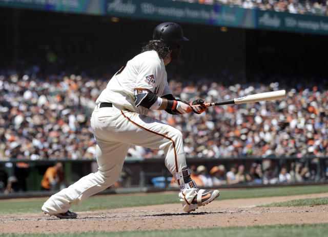 San Francisco Giants' Brandon Crawford drives in two runs with a double against the San Diego Padres during the sixth inning of a baseball game Saturday, June 23, 2018, in San Francisco. (AP Photo/Marcio Jose Sanchez)