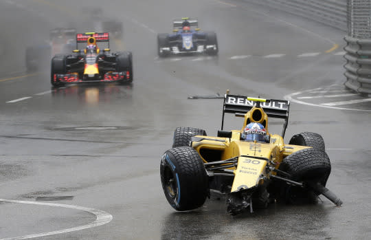 <p>Renault driver Jolyon Palmer of Britain steers his damaged car after crashing into a wall during the Formula One Grand Prix at the Monaco racetrack in Monaco, Sunday, May 29, 2016. <em>(AP Photo/Petr David Josek)</em> </p>