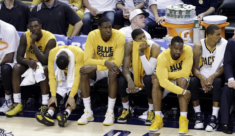 Indiana Pacers players, from left, Lance Stephenson, D.J. Augustin, Ian Mahinmi, Paul George, Sam Young and George Hill watch late in Game 3 of the NBA Eastern Conference basketball finals against the Miami Heat in Indianapolis, Sunday, May 26, 2013. The Heat won 114-96. (AP Photo/Michael Conroy)