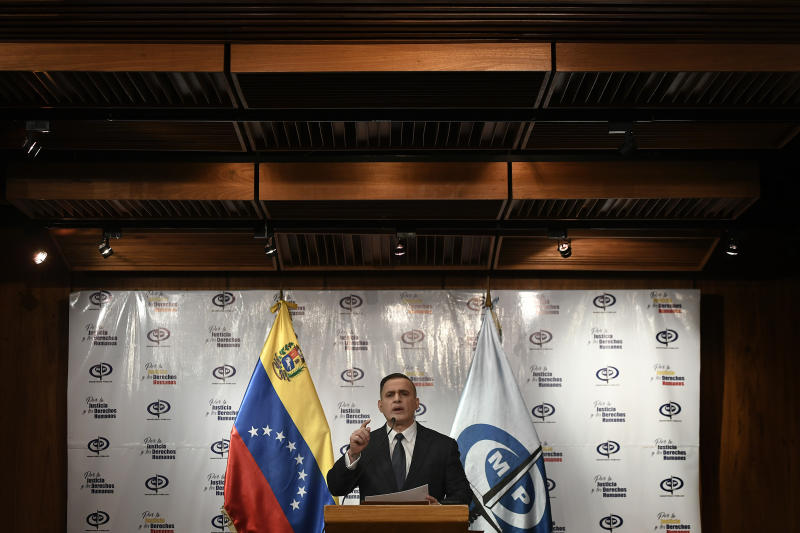 Venezuela's Attorney General Tarek William Saab gives a press conference regarding what the government calls a failed attack over the weekend aimed at overthrowing President Nicolás Maduro in Caracas, Venezuela, Friday, May 8, 2020. (AP Photo/Matias Delacroix)