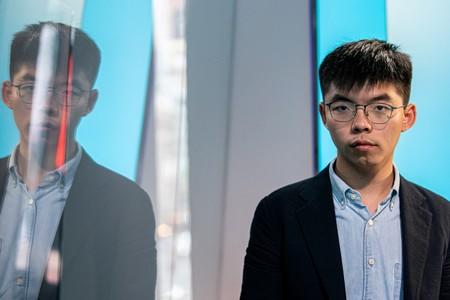 FILE PHOTO: Hong Kong pro-democracy activist Joshua Wong poses during an interview at the Reuters New York office