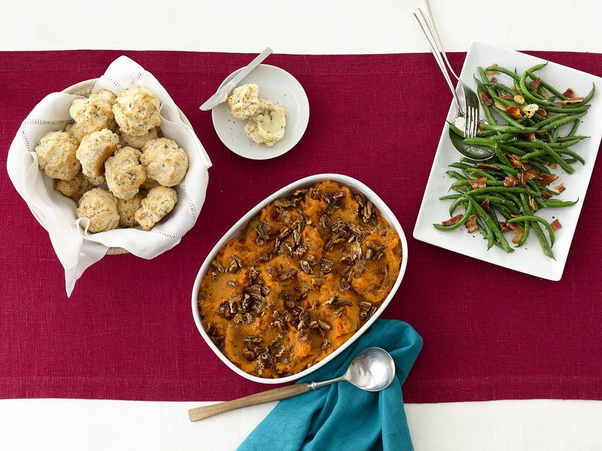 """<p>Decorate your mashed potatoes with pecans, rosemary, and maple syrup instead of sour cream. </p><p><em><a href=""""https://www.womansday.com/food-recipes/food-drinks/recipes/a12148/mashed-sweet-potatoes-rosemary-pecans-recipe-wdy1112/"""" target=""""_blank"""">Get the recipe for Mashed Sweet Potatoes with Rosemary Pecans.</a></em></p>"""
