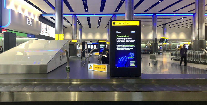 """Government warnings about Coronavirus in the Baggage Hall of London's Heathrow Airport's Terminal 2 the day after the Prime Minister said that Covid-19 """"is the worst public health crisis for a generation"""", and the government's top scientist warned that up to 10,000 people in the UK are already infected."""