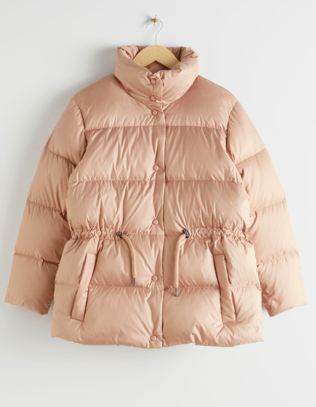 "There's no such thing as enough neutrals. $249, & Other Stories. <a href=""https://www.stories.com/en_usd/clothing/jackets-coats/pufferjackets/product.drawstring-waist-puffer-jacket-orange.0770277001.html"" rel=""nofollow noopener"" target=""_blank"" data-ylk=""slk:Get it now!"" class=""link rapid-noclick-resp"">Get it now!</a>"