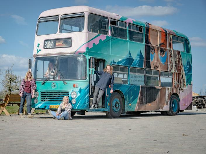 the exterior of the double decker bus with the four women