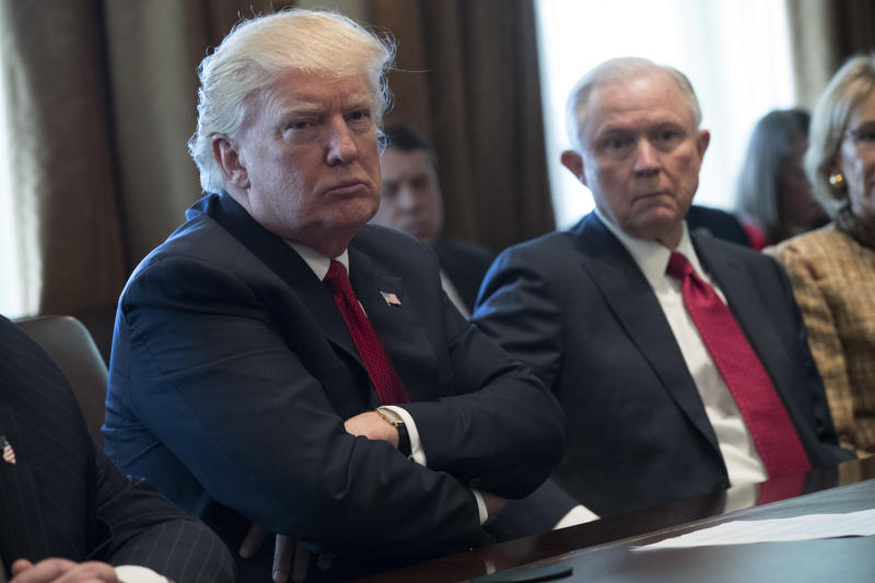 U.S. President Donald Trump (L) and Attorney General Jeff Sessions (R) attend a panel discussion on an opioid and drug abuse in the Roosevelt Room of the White House March 29, 2017 in Washington, DC. (Photo by Shawn Thew-Pool/Getty Images)