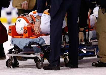 BOSTON, MA - DECEMBER 07: Brooks Orpik #44 of the Pittsburgh Penguins is carted off of the ice on a stretcher by the medical staff in the first period after an altercation with Shawn Thornton #22 of the Boston Bruins during the game at TD Garden on December 7, 2013 in Boston, Massachusetts. (Photo by Jared Wickerham/Getty Images)