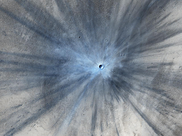 <p>An impact crater on Mars is seen in an image taken by the High Resolution Imaging Science Experiment (HiRISE) camera on NASA's Mars Reconnaissance Orbiter on November 19, 2013 and released February 5, 2014. The crater spans approximately 100 feet (30 meters) in diameter and is surrounded by a large, rayed blast zone. (Photo: NASA/JPL-Caltech/Univ. of Arizona/Reuters) </p>