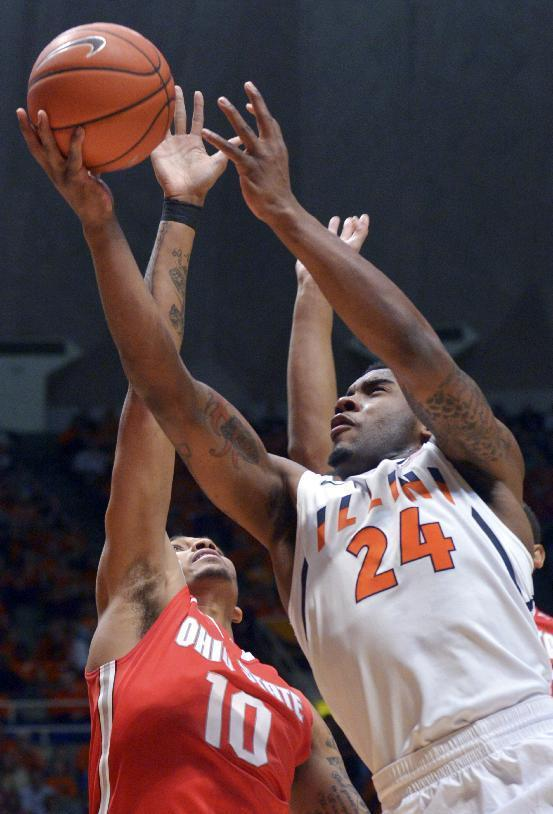 Illinois' Rayvonte Rice (24) shoots past Ohio State's forward LaQuinton Ross (10) to score during the first half of an NCAA college basketball game in Champaign, Ill., on Saturday, Feb. 15, 2014. (AP Photo/Robin Scholz)