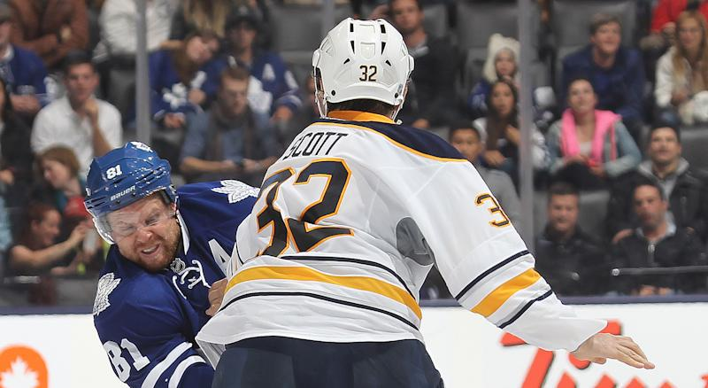 John Scott played nearly 300 regular season games in the NHL, but his clash with Mr. 'The Thrill' during a preseason contest in 2013 may be the most iconic moment of his career. (Photo by Claus Andersen/Getty Images)