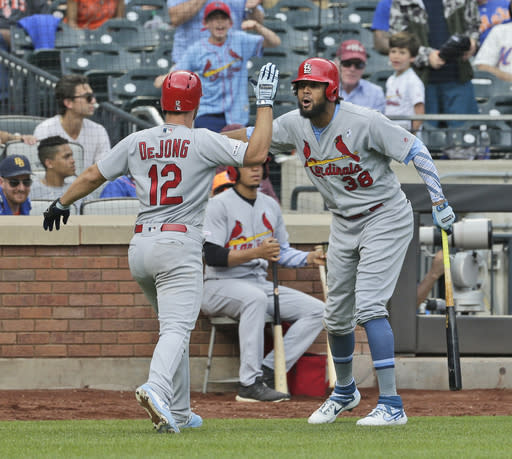 St. Louis Cardinals' Jose Martinez, right, celebrates Paul DeJong's (12) solo home run during the eighth inning of a baseball game against the New York Mets at Citi Field, Sunday, June 16, 2019, in New York. (AP Photo/Seth Wenig)