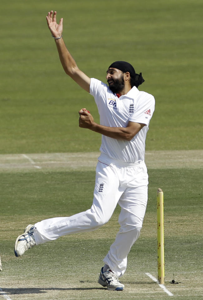 England's bowler Monty Panesar bowls a delivery during the third day of the second cricket test match of a three match series between England and Pakistan at the Zayed Cricket Stadium in Abu Dhabi, United Arab Emirates, Friday, Jan. 27, 2012. (AP Photo/Hassan Ammar)
