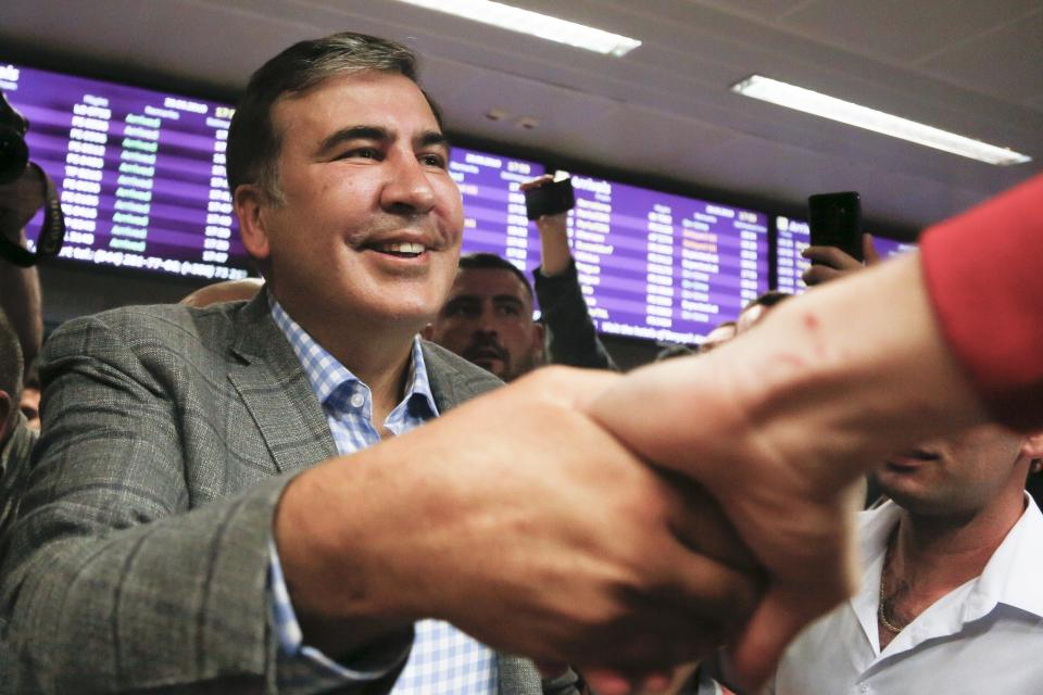 FILE - In this May 29, 2019, file photo, Georgia's former President Mikheil Saakashvili greets supporters upon arrival at Boryspil Airport, outside Kyiv, Ukraine. Georgia Prime Minister Irakli Garibashvili announced Friday, Oct. 1, 2021, that Saakashvili was been arrested. The announcement came about 18 hours after Saakashvili, who was convicted in absentia and has lived in Ukraine in recent years, posted on Facebook that he had returned to the country. (AP Photo/Efrem Lukatsky, File)