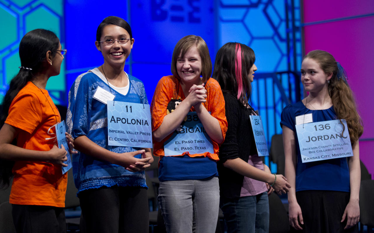 Contestants, from left, Kavyapranati Pratapa of Ypsilanti, Mich., Apolonia Gardner of Imperial, Calif., Abigal Violet Spitzer of El Paso, Texas, Vismaya Jui Kharkar of Bountiful, Utah, and Jordan Gabriella Hoffman of Lee's Summit, Mo., celebrate after learning they qualified for the semifinal round of the National Spelling Bee on Wednesday, May 30, 2012 in Oxon Hill, Md.   (AP Photo/Evan Vucci)