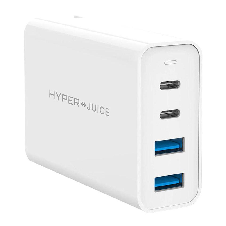 """<p><strong>HYPER</strong></p><p>amazon.com</p><p><strong>$99.00</strong></p><p><a href=""""https://www.amazon.com/Charger-MacBook-HyperJuice-Charging-Station/dp/B08B62B63Q?tag=syn-yahoo-20&ascsubtag=%5Bartid%7C2089.g.1219%5Bsrc%7Cyahoo-us#customerReviews"""" rel=""""nofollow noopener"""" target=""""_blank"""" data-ylk=""""slk:Shop Now"""" class=""""link rapid-noclick-resp"""">Shop Now</a></p><p>Although this wall charger from HyperJuice is a little pricey, it's arguably one of the most powerful chargers on the market. Not only is it equipped with two USB-A ports, it also features dual USB-C ports, meaning it offers the ability to quick charge a laptop, a tablet, smartphone, and earbuds or smartwatch all at the same time.<br></p><p>The charger features foldable prongs and safety protection against over-current, over-voltage, overheating, and short circuits. If you can stomach its $100 price, it's well worth it. This will surely become the most portable and versatile charger you own.</p><p>If the HyperJuice's $100 price is a bit out of reach, AUKEY recently released a <a href=""""https://www.amazon.com/dp/B08GFBLGKY?th=1&tag=syn-yahoo-20&ascsubtag=%5Bartid%7C2089.g.1219%5Bsrc%7Cyahoo-us"""" rel=""""nofollow noopener"""" target=""""_blank"""" data-ylk=""""slk:100-Watt 4-port charger"""" class=""""link rapid-noclick-resp"""">100-Watt 4-port charger</a> that we hope to test soon.</p>"""