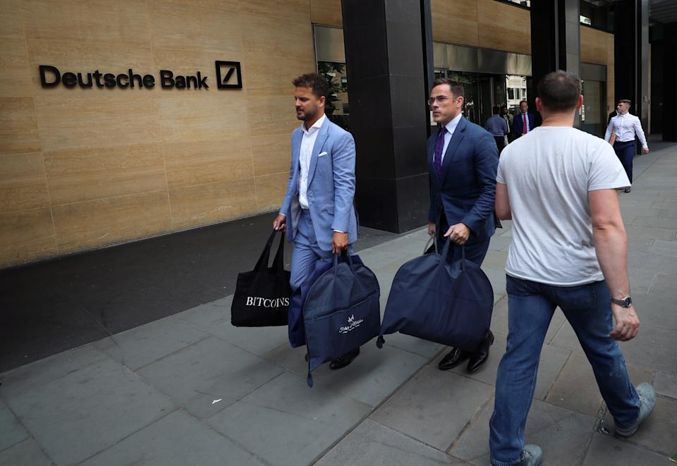 People carry bags outside a Deutsche Bank office in London, Britain July 8, 2019. REUTERS/Simon Dawson