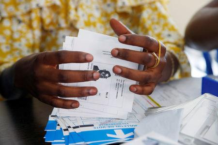 A Congo's Independent National Electoral Commission (CENI) official holds a ballot of Martin Fayulu, Congolese joint opposition Presidential candidate during the counting of presidential elections ballots at tallying centre in Kinshasa, Democratic Republic of Congo, January 4, 2019. REUTERS/Baz Ratner/Files
