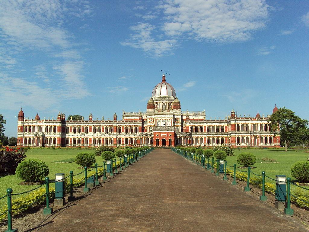"""<p>Cooch Behar Palace, also called the Victor Jubilee Palace, is a landmark in Cooch Behar city, West Bengal. It was modeled after the Buckingham Palace in London in 1887, during the reign of Maharaja Nripendra Narayan. The Cooch Behar Palace, noted for its elegance and grandeur, is a property of The Mantri's. (Image: <a rel=""""nofollow"""" href=""""https://commons.wikimedia.org/wiki/File:Cooch_Behar_Palace_in_Cooch_Behar.JPG"""">Wikimedia Commons</a>) </p>"""