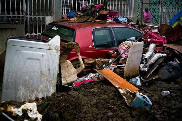 <p>Items destroyed by flooding from Hurricane Maria sit in the street, waiting to be picked up by the garbage service, in Toa Baja, Puerto Rico, Monday, Oct. 16, 2017. With hundreds of thousands of people still without running water, and 20 of the island's 51 sewage treatment plants out of service, there are growing concerns about contamination and disease. (Photo: Ramon Espinosa/AP) </p>