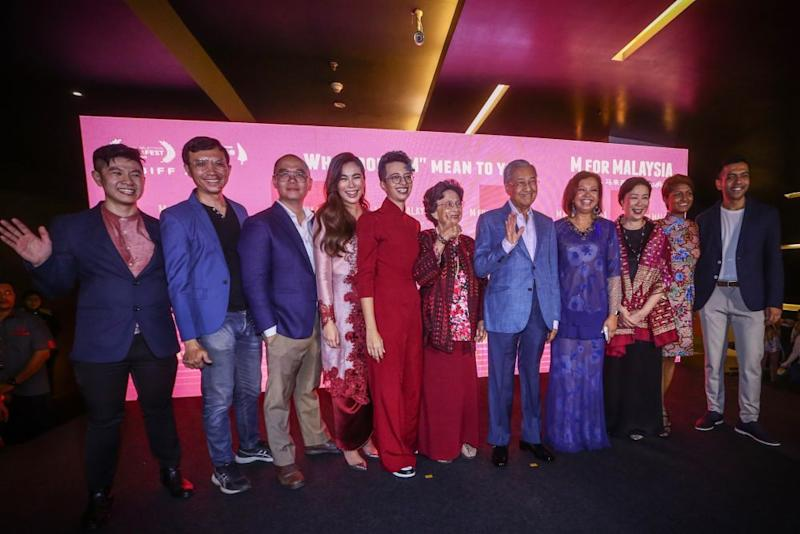 Prime Minister Tun Dr Mahathir Mohamad and Tun Dr Siti Hasmah Mohd Ali pose for a group picture with the production team of 'M for Malaysia' during its premiere at GSC Pavilion, Kuala Lumpur September 10, 2019. — Picture by Hari Anggara