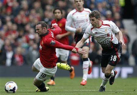 Liverpool's Flanagan pulls back Manchester United's Rooney during their English Premier League soccer match in Manchester