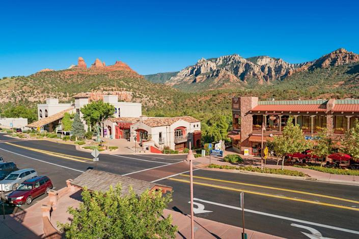 """<p>Although it's become a really popular spot, Sedona is still a desert town. Located near Flagstaff, it's surrounded by the famously beautiful red-rock buttes Arizona is known for, as well as steep canyon walls and pine forests. The mild climate makes it an ideal place to hike and explore nature. Uptown Sedona is an artist's paradise. If you're the hiking type, make sure to find some of the <a href=""""https://www.sedona.net/vortex-map"""" rel=""""nofollow noopener"""" target=""""_blank"""" data-ylk=""""slk:vortexes"""" class=""""link rapid-noclick-resp"""">vortexes</a>. <br></p>"""