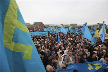 Crimean Tatars gather to commemorate mass deportations from region in 1944 during a rally in Crimean capital Simferopol