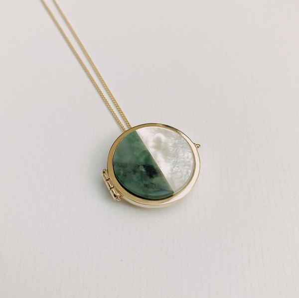 <p>This <span>Ursa Major Stone Locket</span> ($480) is made of jade and pearl and is an incredible healing piece. When jade is struck, it emits a melodious sound resembling a loved one. It is the ultimate stone of peace and well-being - something we could all use more of in 2020. </p>