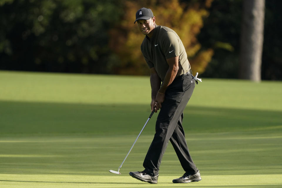 Tiger Woods watches his ball as he misses a birdie putt on the eighth hole during the first round of the Masters golf tournament Thursday, Nov. 12, 2020, in Augusta, Ga. (AP Photo/Charlie Riedel)