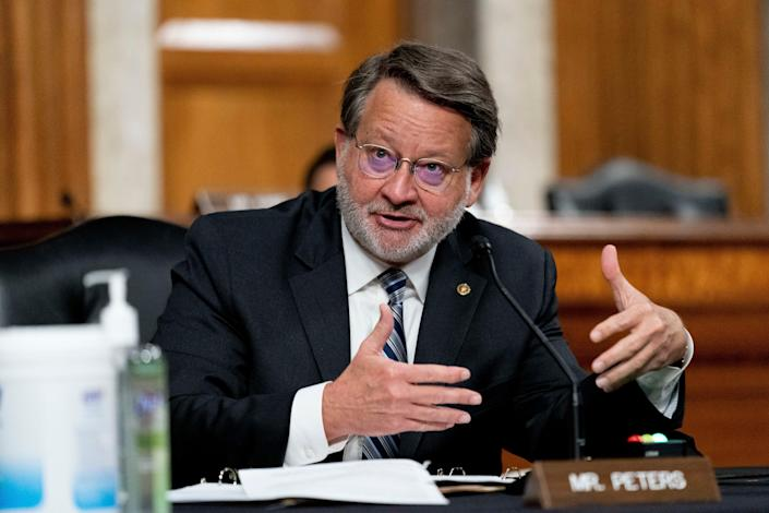 Sen. Gary Peters, D-Mich., speaks at a hearing on Capitol Hill, Thursday, March 25, 2021, in Washington.