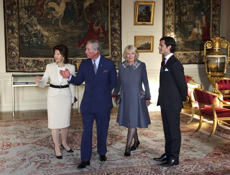 Britain's Prince Charles, 2nd left, and Camilla, Duchess of Cornwall,2nd right, are received by Sweden's Queen Silvia, left, and Prince Carl Philip at Stockholm Royal Palace Thursday March 22, 2012. (AP Photo/Scanpix,Henrik Montgomery) SWEDEN OUT